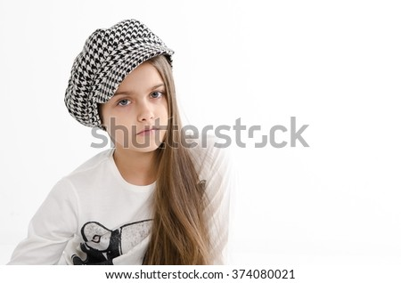 beautiful teen girl. beauty woman portrait of teen girl beautiful cheerful with clean skin. schoolgirl with long hair in checkered cap - stock photo