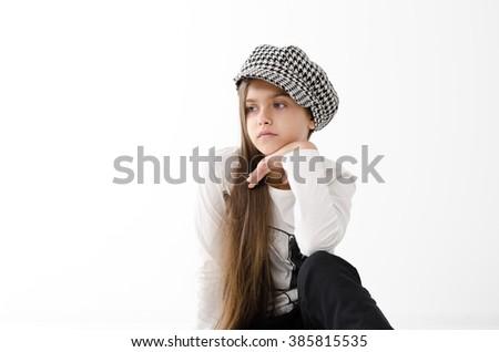 beautiful teen girl. beauty woman portrait of teen girl beautiful cheerful with clean skin. schoolgirl with long hair in checkered cap. portrait of teen girl - stock photo