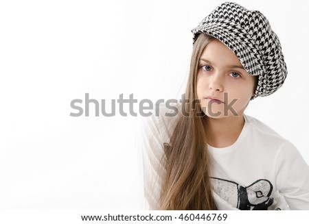 beautiful teen girl. beauty woman portrait of teen girl beautiful cheerful with clean skin. schoolgirl with long hair in checkered cap. space for text - stock photo