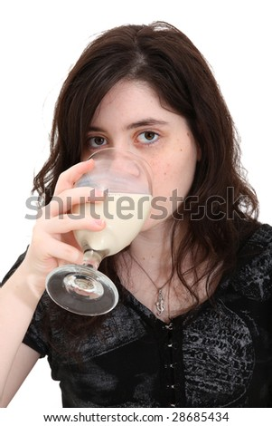 Beautiful teen girl drinking glass of soymilk (soy milk) over white background. - stock photo