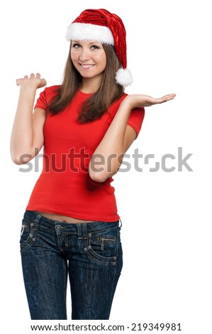 Beautiful teen girl in Santa hat posing on white background