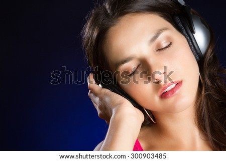 Beautiful teen girl listening to headphones music - stock photo