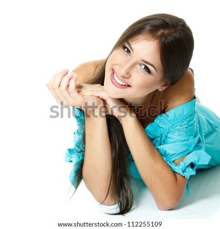 Beautiful teen girl lying in blue dress  and smiling. Isolated on white background - stock photo
