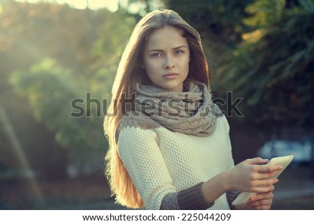 Beautiful teen girl posing with tablet - stock photo
