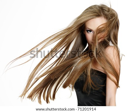 Beautiful teen girl shaking head with long hair on white background - stock photo