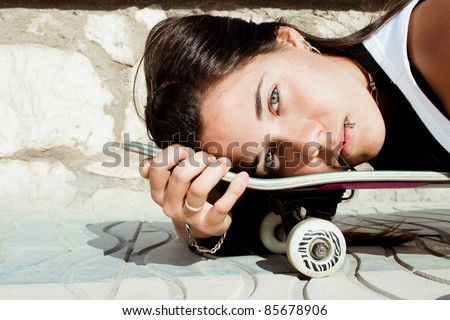 Beautiful teen girl to skate in the park - stock photo