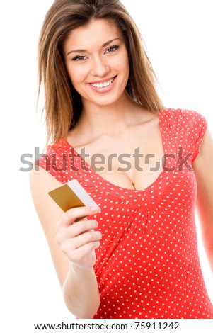 Beautiful teen girl with blank credit card - stock photo