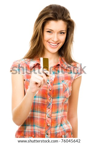 Beautiful teen girl with blank credit card - stock photo