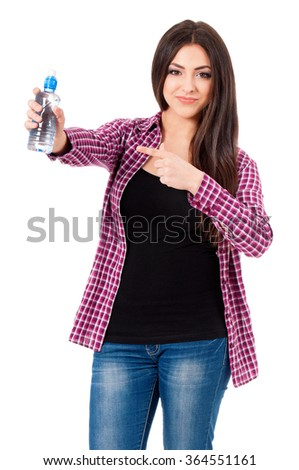 Beautiful teen girl with bottle of water posing on white background - stock photo