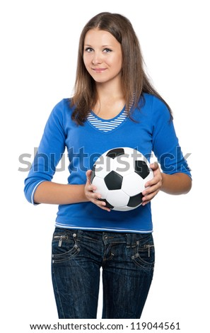 Beautiful teen girl with classic soccer ball posing on white background - stock photo