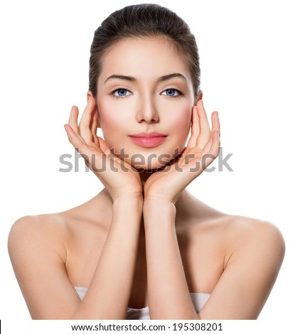 Beautiful Teen girl with Clean Fresh Skin touching her face. Close up portrait isolated on white. Beautiful Spa Woman Smiling. Fresh Skin. Beauty Teenage Model. Youth and Skin Care - stock photo