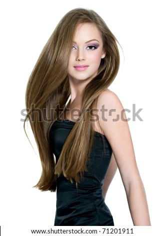 Beautiful teen girl with  long straight hair, posing on white background - stock photo