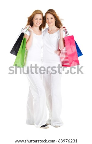 beautiful teen girls carrying shopping bags, isolated on white