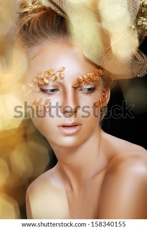 Beautiful Teen Model Fashion Glamour Makeup and Hairstyle. Glamor Golden Make-up.Holiday Gold Makeup