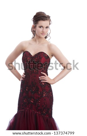 Beautiful teen ready for prom.  Isolated on white. - stock photo