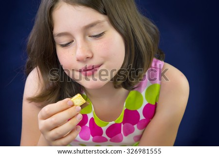 Beautiful teenage girl eating chocolate. Happy and smiling