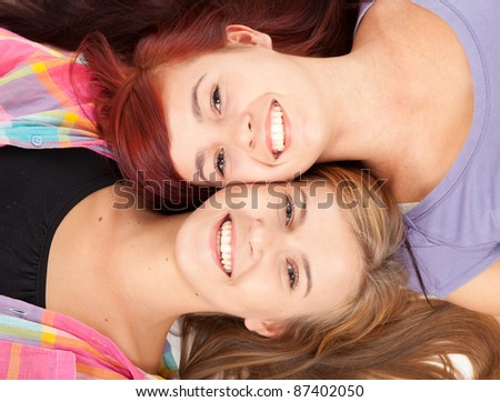 beautiful teenage girl friends lying head to head