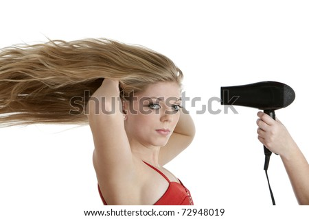 Beautiful teenage girl having her hair blown