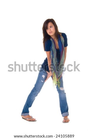 Beautiful teenage girl in casual fashions including jeans and a multi color scarf