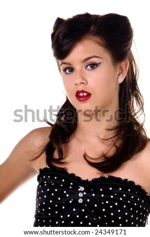 Beautiful teenage girl in 1950's rockabilly fashion polka dot dress, hair and makeup - stock photo