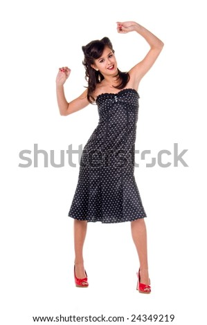 Beautiful teenage girl in 1950's rockabilly fashion polka dot dress, hair and red clutch purse - stock photo