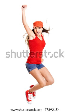 Beautiful teenage girl jumping of happiness isolated on white - stock photo