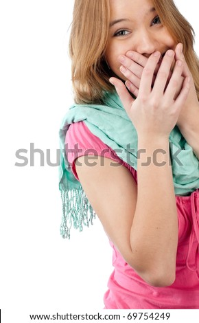 beautiful teenage girl laughing with hands on her mouth, isolated on white background - stock photo