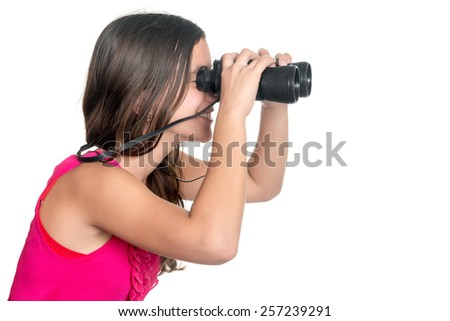 Beautiful teenage girl looking through a pair of binoculars isolated on white - stock photo