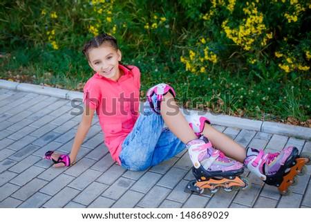 beautiful teenage girl on roller skates - stock photo