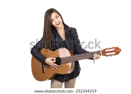 Beautiful teenage girl playing guitar and singing  isolated on white background - stock photo