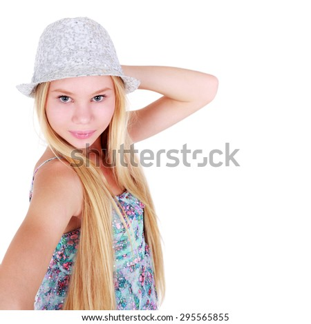 beautiful teenage girl posing in the summer dress with the hat - stock photo