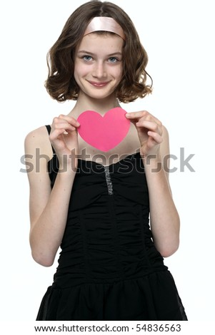Beautiful teenage girl showing Valentine heart.  She in love.