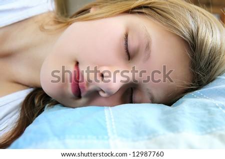 Beautiful teenage girl sleeping in the morning - stock photo