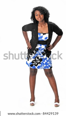Beautiful teenage girl wearing a dress, sweater and heels is posing on a white background with space for copy. - stock photo