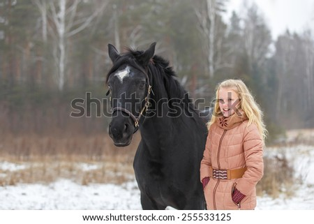 Beautiful teenage girl with a horse. - stock photo