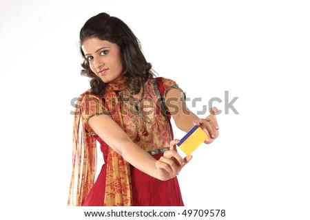 Beautiful teenage girl with credit card - stock photo