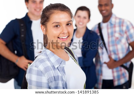 beautiful teenage girl with group of schoolmates over white background - stock photo