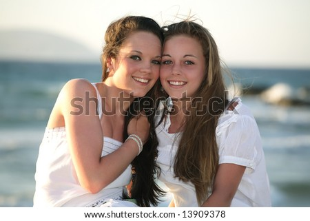 beautiful teenage girls over sea and sunset background