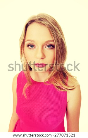 Beautiful teenage woman wearing pink skirt