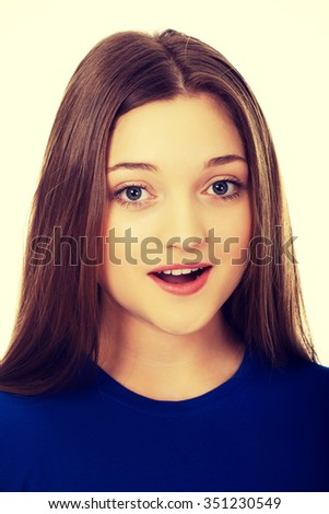 Beautiful teenage woman with shock expression. - stock photo