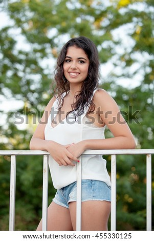 Beautiful teenager brunette girl with jeans shorts - stock photo