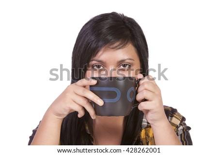 Beautiful  Teenager Girl Drinking Coffee at Home - stock photo