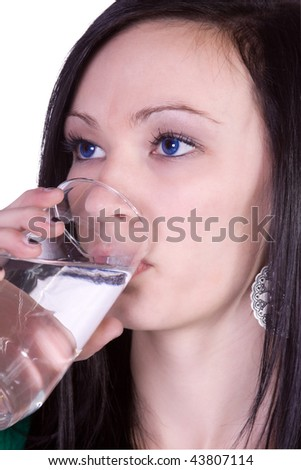 Beautiful Teenager Girl Drinking Water on an Isolated Background