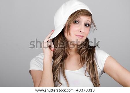 Beautiful Teenager Girl in a White Baseball Cap - stock photo