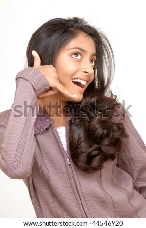 beautiful teenager girl making call sign - stock photo