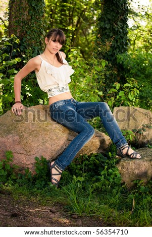 Beautiful teenager girl outside during a summer day in the park. - stock photo