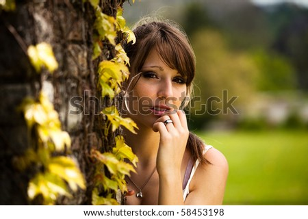Beautiful teenager girl outside during a summer day in the park.