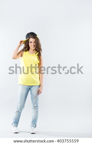 Beautiful teenager. Portrait of a teen girl full-length. - stock photo