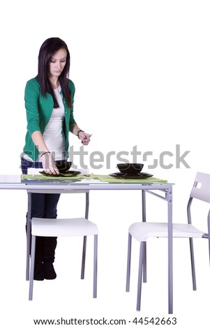 Beautiful Teenager Preparing the Dinner Table - Isolated - stock photo