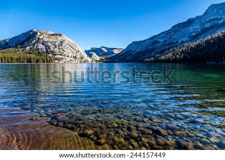 Beautiful Tenaya lake and mountains reflection, Yosemite National park - stock photo
